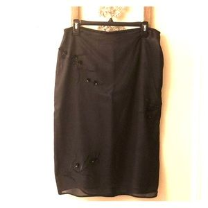 Black skirt with floral embellishments